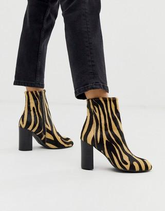 Asos DESIGN Rescue leather block heel boots in zebra pony