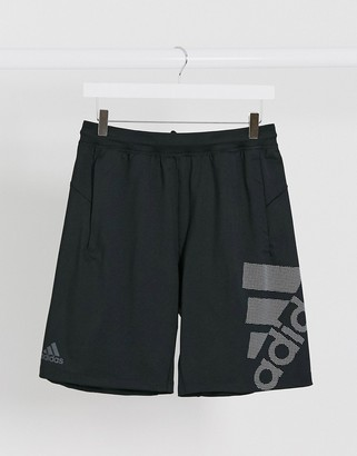 adidas Training graphic logo shorts in black