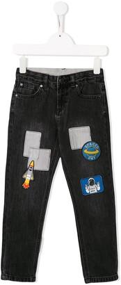 Stella McCartney space patch jeans
