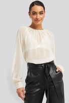 NA-KD Round Neck Dotted Flowy Blouse