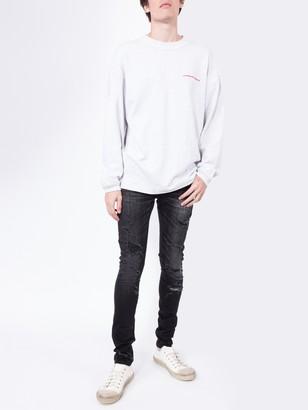 Balmain Distressed Slim-fit Jeans Black