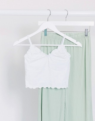 ASOS DESIGN cropped cami with lettuce edge and bust seam detail in white