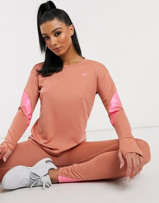 Nike Running mid layer in blush and pink