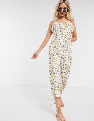 ASOS DESIGN cami tie front jumpsuit in yellow floral print
