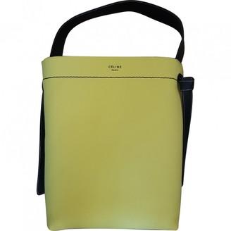 Celine Twisted Yellow Cloth Handbags
