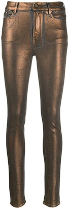 Coated Metallic Skinny Jeans
