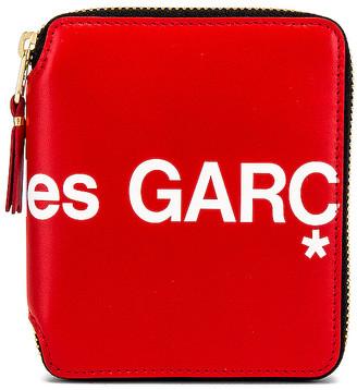 Comme des Garcons Huge Logo Wallet in Red   FWRD