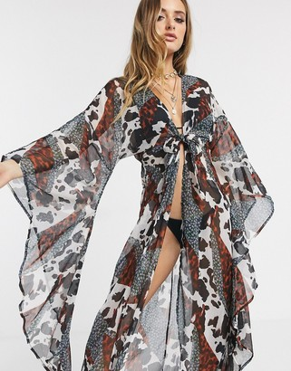 ASOS DESIGN glam maxi beach kimono with exaggerated sleeves in spliced animal floral print