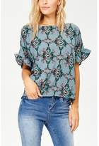Jane Plus One Teal Blue Print Top With Ruffled Short Sleeves.