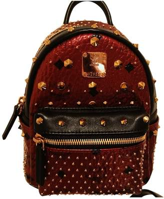 MCM Stark Metallic Leather Backpacks