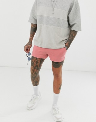 Asos Design DESIGN jersey runner shorts in pink