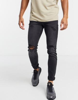 Jack and Jones Intelligence Liam skinny fit jeans with rips in black