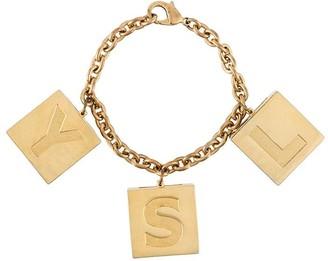 Saint Laurent 1990s makeup charms bracelet