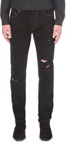 Saint Laurent Distressed slim-fit skinny jeans