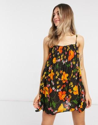 ASOS DESIGN flutter edge beach sundress in enchanted floral print