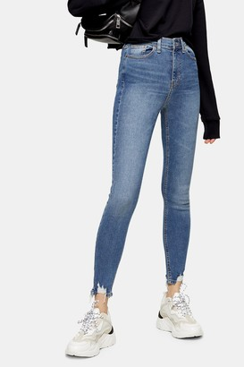 Topshop CONSIDERED Mid Blue Jagged Hem Jamie Jeans With Recycled Cotton
