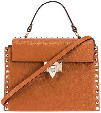 Valentino Rockstud Top Handle Bag in Selleria   FWRD