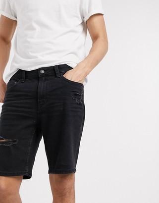 Bershka denim shorts in skinny fit with rips in black
