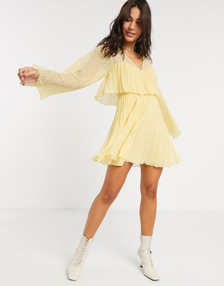 Asos DESIGN double layer pleated mini dress in yellow