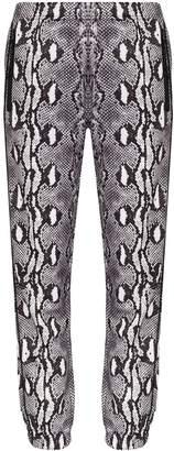 Adam Selman snake print track pants