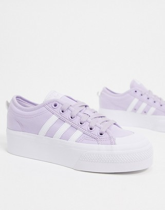 adidas Nizza platform trainers in lilac and white