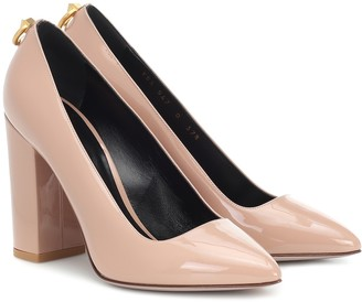 Valentino Ringstud patent leather pumps