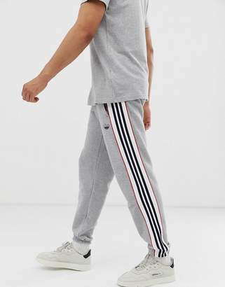 adidas joggers with outline 3 stripes in grey