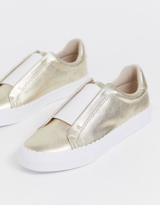 ASOS DESIGN Devoted slip on sneakers in champagne gold