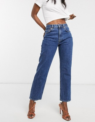 ASOS DESIGN high rise stretch 'slim' straight leg jeans in mid vintage wash