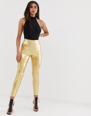 ASOS DESIGN pull on jegging in washed metallic gold