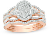 Zales 1/3 CT. T.W. Composite Diamond Oval Frame Bridal Set in 10K Rose Gold