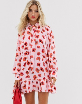 Glamorous mini smock dress with neck tie and peplum hem in poppy print-Pink