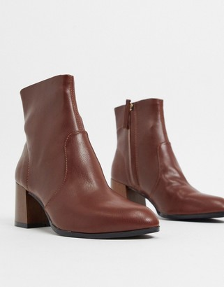 ASOS DESIGN Reporter heeled boots with flared wooden heel in brown