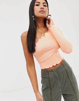 Asos Design DESIGN one shoulder long sleeve crop t-shirt with lettuce hem in coral-Pink