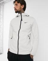 Nike Tech Pack zip-through hoodie in stone