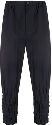 Issey Miyake Pleated-Hem Cropped Pinstriped Trousers