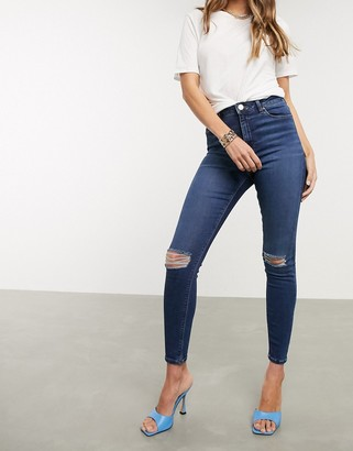ASOS DESIGN high rise ridley 'skinny' jeans in dark stonewash blue with busted knees