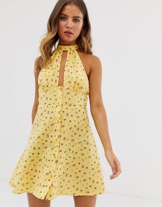 ASOS DESIGN halter neck button through mini sundress in ditsy floral print