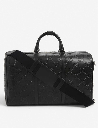 Gucci GG logo-embossed leather duffle bag