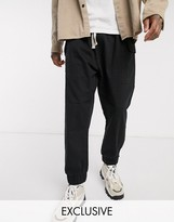 Reclaimed Vintage inspired drop crotch cargo pants with drawstring in black