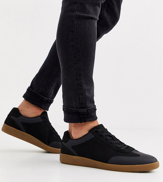 ASOS DESIGN Wide Fit lace up trainers in black faux suede with gum sole