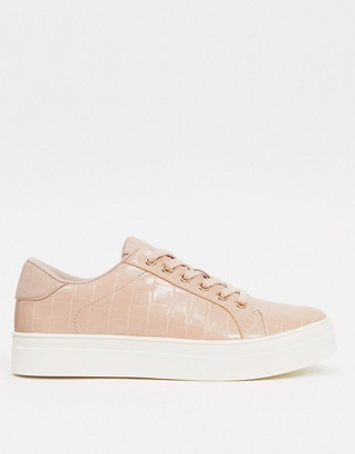Accessorize chunky flatform trainers in pink croc