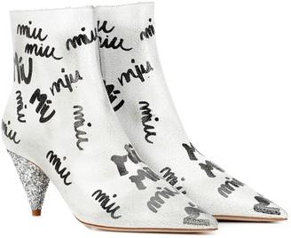 Miu Miu Printed leather ankle boots