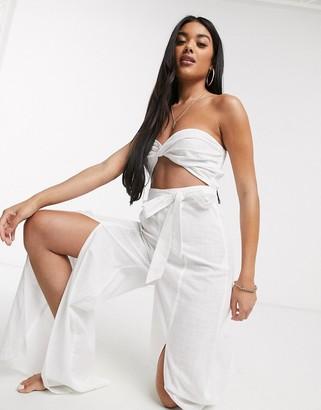 Asos Design DESIGN bandeau beach jumpsuit with split legs in self stripe in white