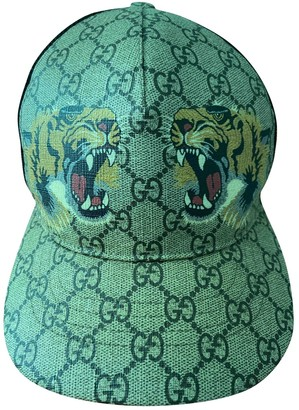 Gucci Gold Leather Hats & pull on hats