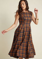 BBAW170802C Keep your ensemble following engaged by switching things up with showstopping styles - like this plaid midi dress! Undeniably nostalgic, this fit and flare exemplifies allure with its looped trim around the arms and hem, dimensional pleats, and palette of