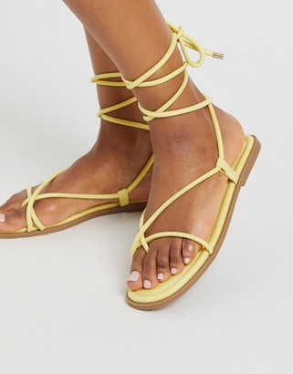 Truffle Collection square toe tie leg flat sandals in yellow