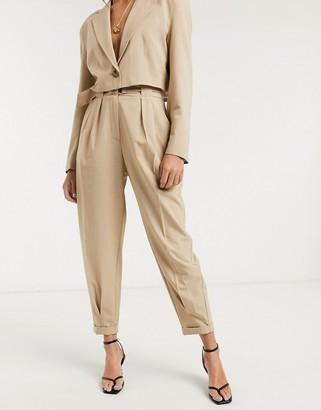 Bershka slouchy tailored trouser in beige