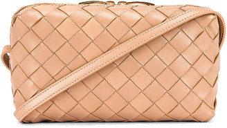 Bottega Veneta Leather Woven Crossbody Bag in Cipria & Gold | FWRD