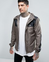 The North Face 1985 Mountain Jacket Hooded in Brown
